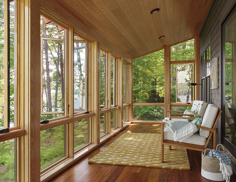 Porch featuring casement windows.
