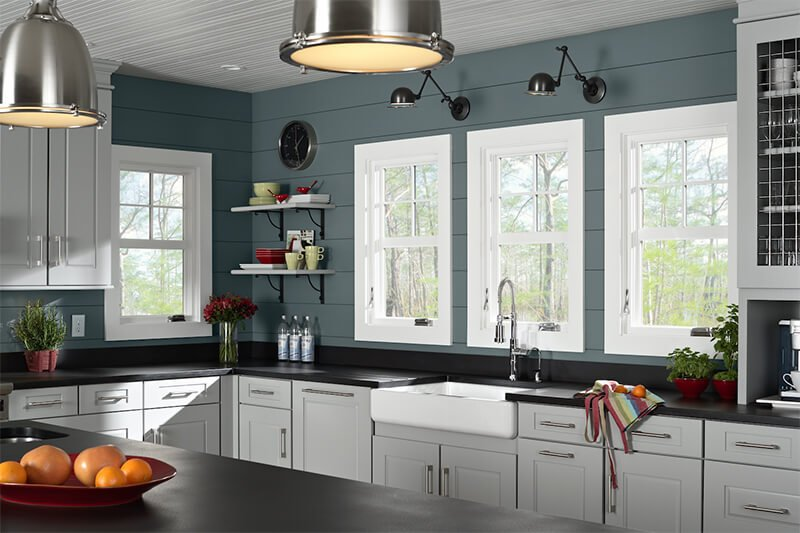 A kitchen with four casement windows.