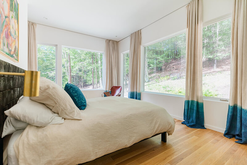 Bedroom with dyed curtains and Marvin Windows