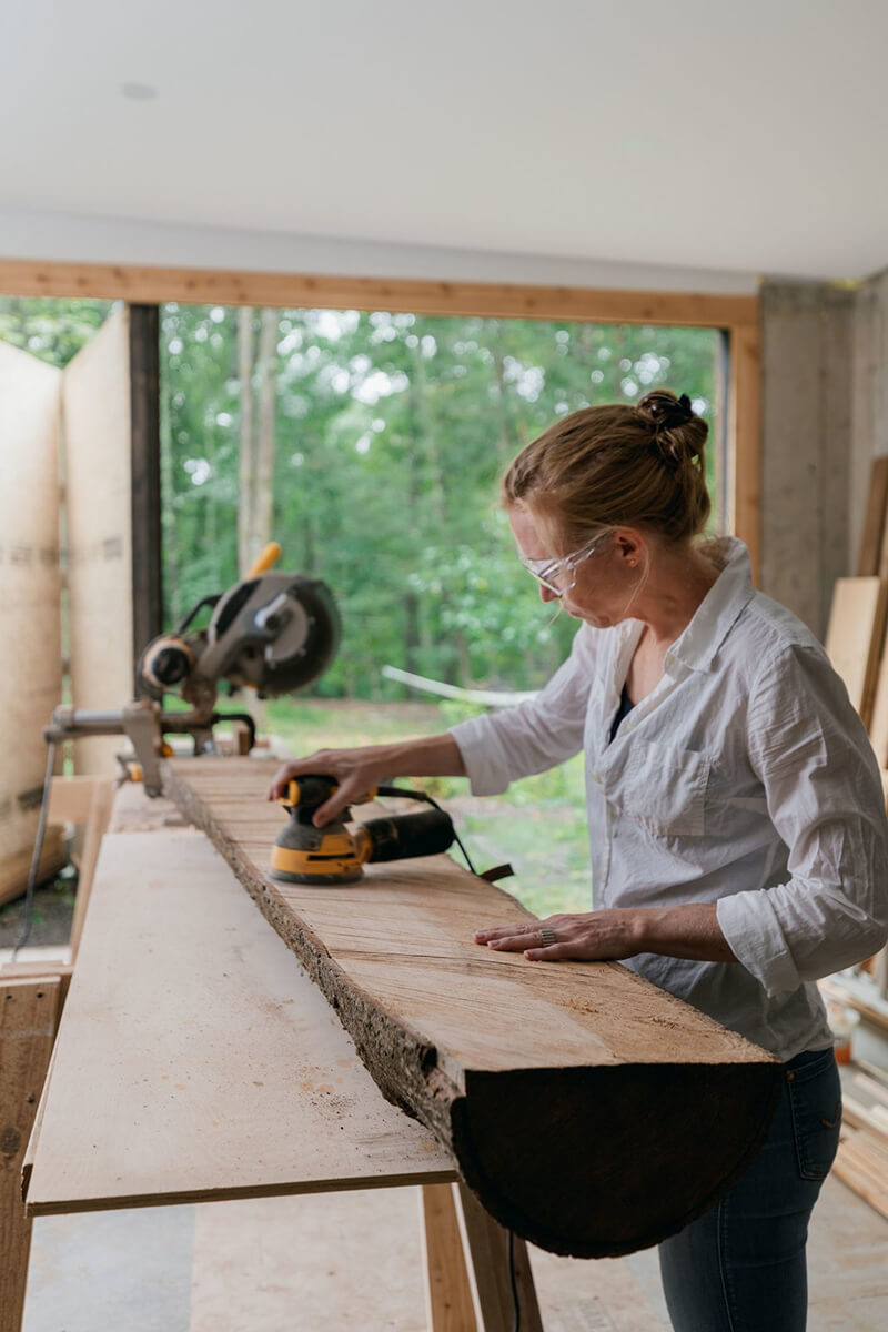 Woman tinkering in workshop and craft room of hillside home with Marvin Windows