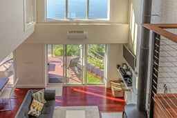 Upper level of beach home with large Marvin Windows and Doors