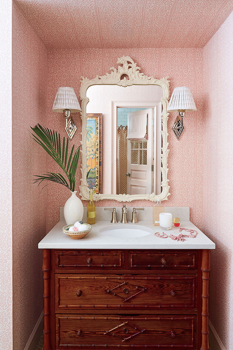 Girls bathroom with wallpaper and mirror and vanity