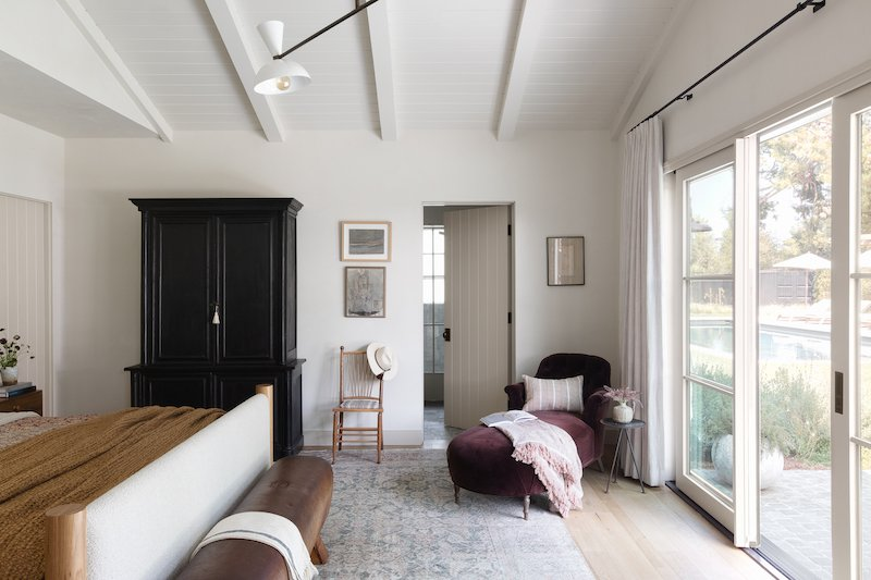 A bedroom in Amber Lewis's Belgian farmhouse-style home, featuring Marvin Signature Ultimate windows and doors.