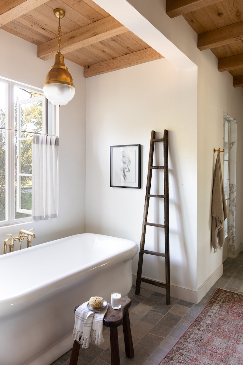 A bathroom in Amber Lewis's farmhouse-style home, featuring Marvin Signature Ultimate Narrow Casement windows.
