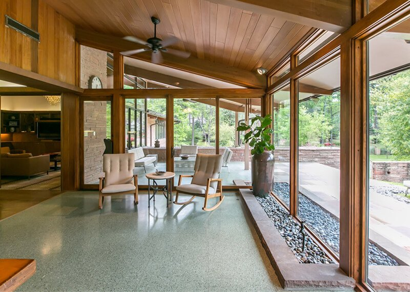 Mid Century enclosed porch with large Marvin Windows and Doors