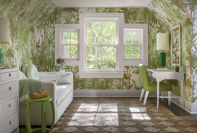 A room featuring gree plant wallpaper.