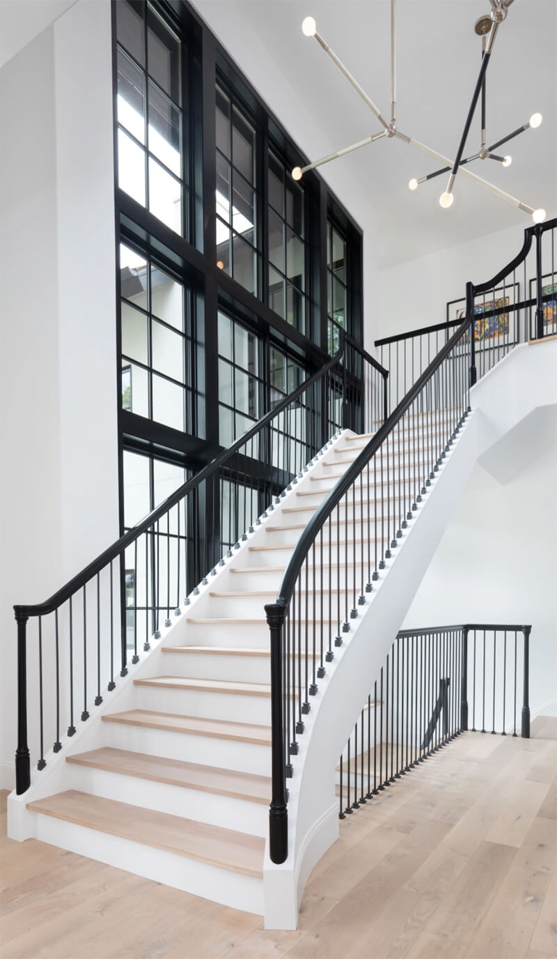 Modern style staircase with multiple large Marvin Windows
