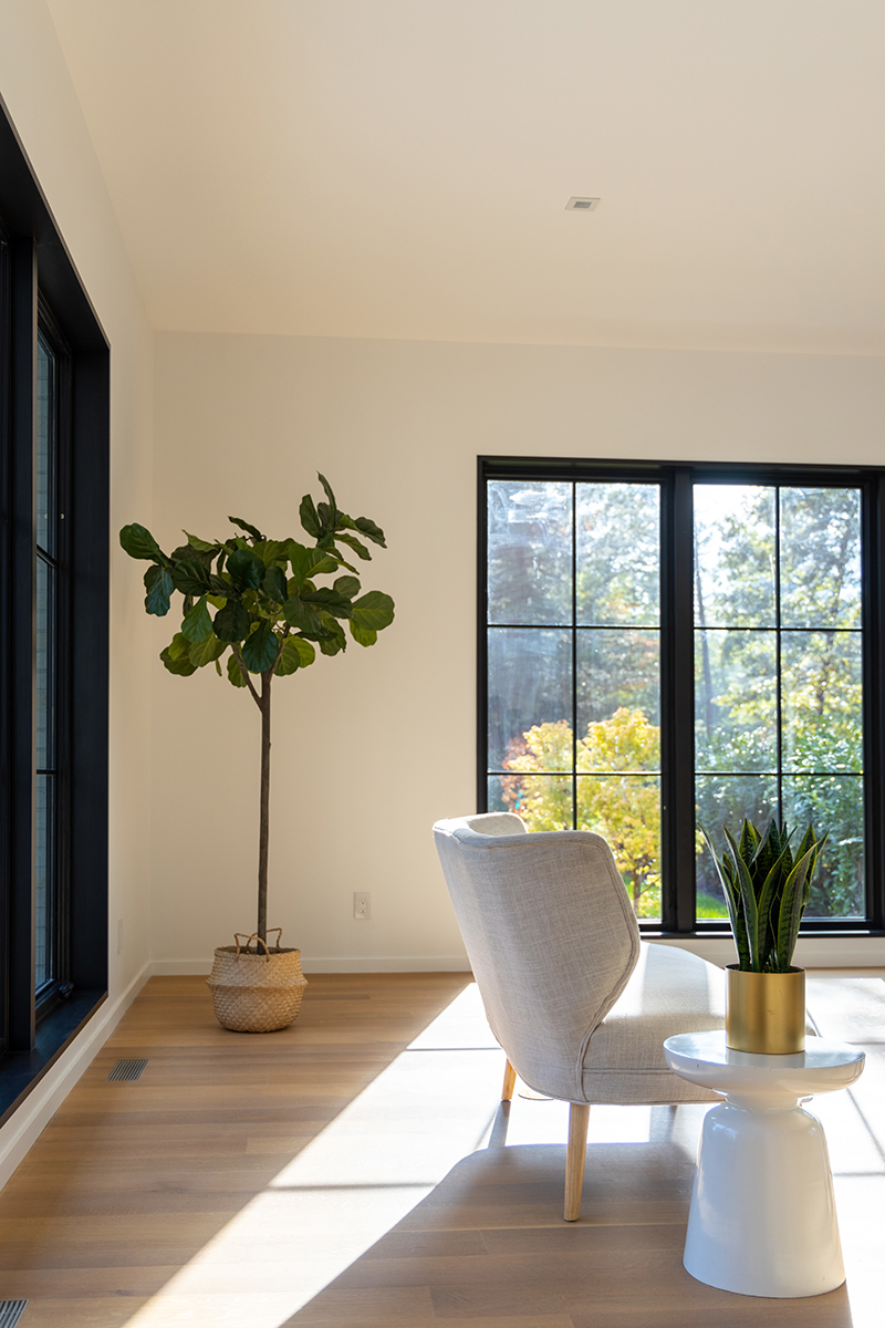 A modern living room featuring black Marvin windows.