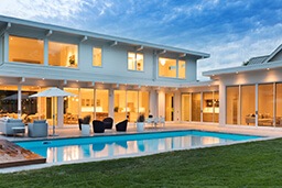 Poolside view of home with multiple Marvin Windows and Doors
