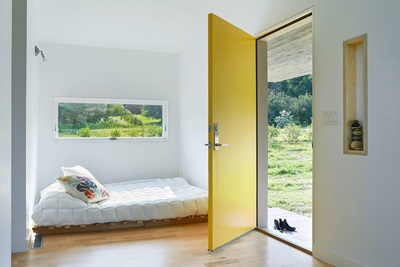 Home with Marvin Window and open Yellow door