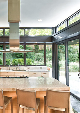 Open concept kitchen with large Marvin Windows and Doors