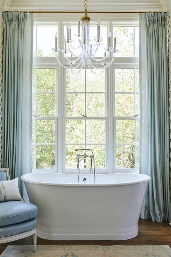 Traditional style bathroom with large Marvin Window