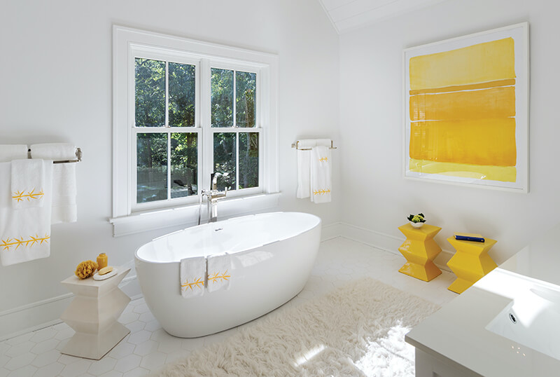Bathroom with white Marvin windows and white interior design
