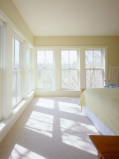 Large bedroom with multiple Marvin Windows