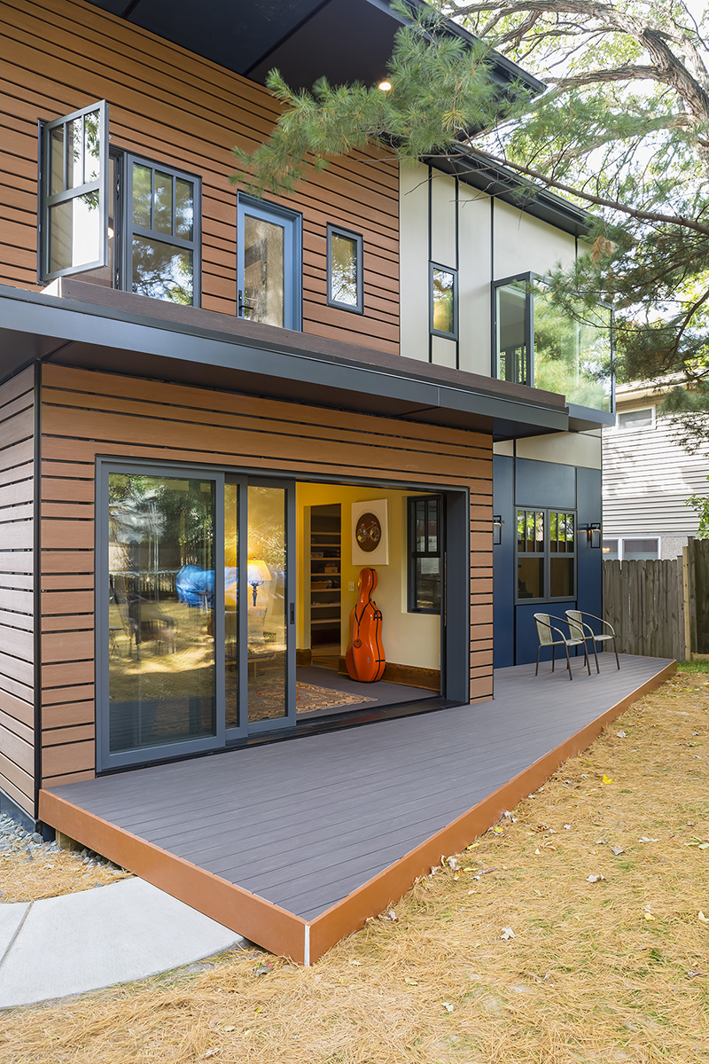An exterior photo of back of Michael Anschel's southwest Minneapolis home, featuring a Marvin Ultimate MultiSlide Door and Modern casement windows.