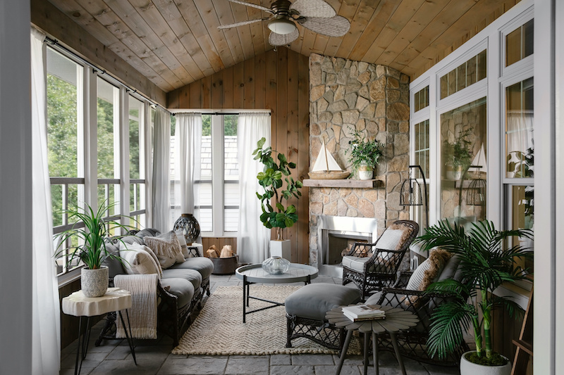 A screened porch with resort style decor and Marvin Elevate double hung and picture windows.