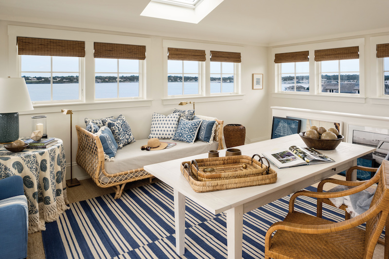 A nautical-themed lounge featuring Marvin Signature Ultimate casement windows.