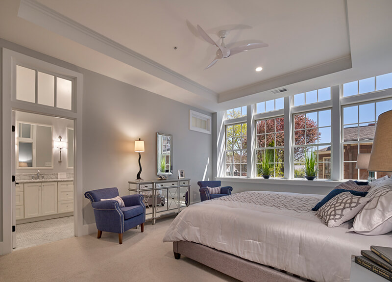 Large bedroom with multiple large Marvin Windows