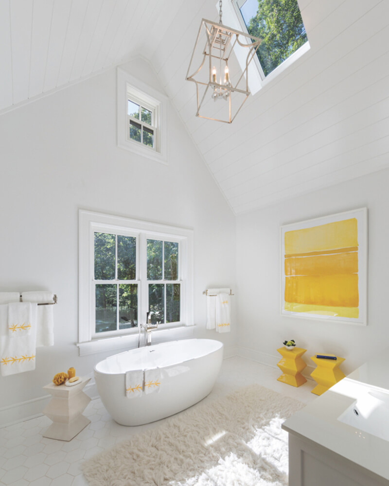 Modern style bathroom with vaulted ceiling and Marvin Windows