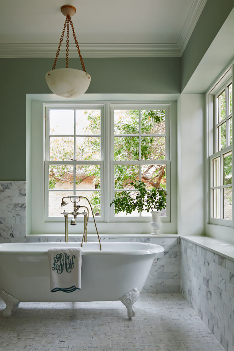 Traditional claw foot tub in front of Marvin Windows