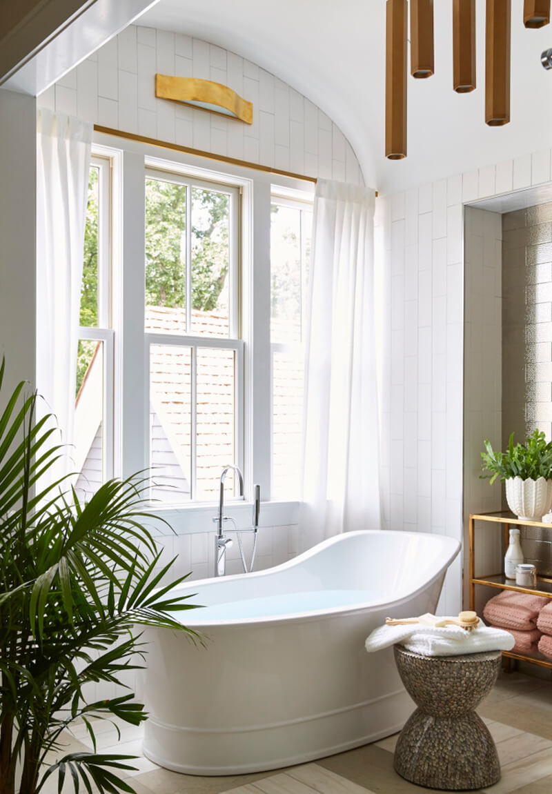 Modern style tub in front of Marvin Window