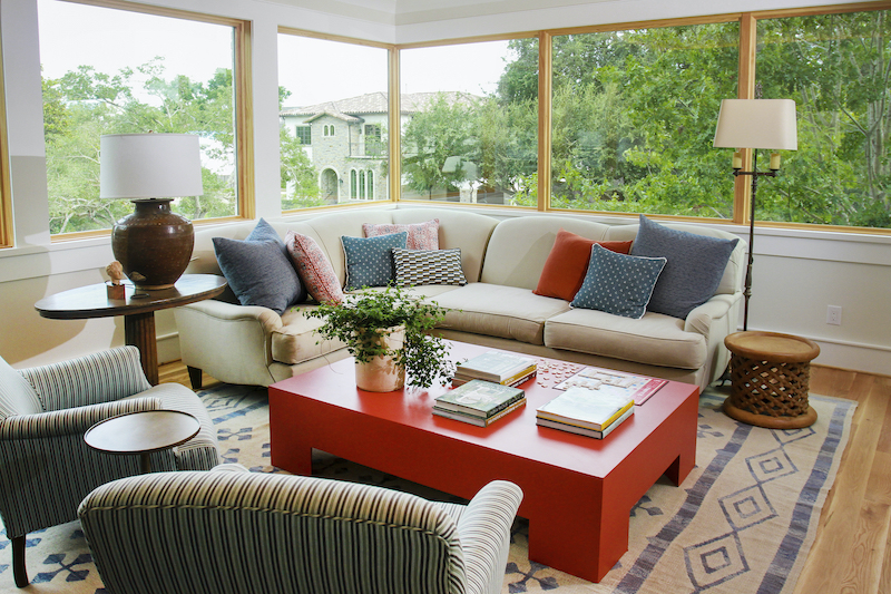 A second-floor sitting area featuring Marvin windows with expansive glass.