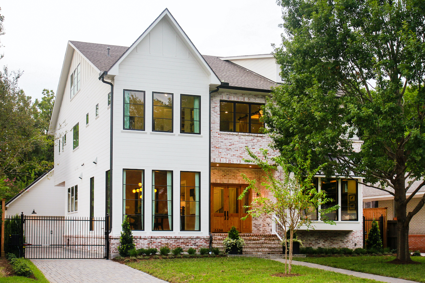 Exterior of a Modern Farmhouse style home in Houston, Texas, featuring Marvin windows.