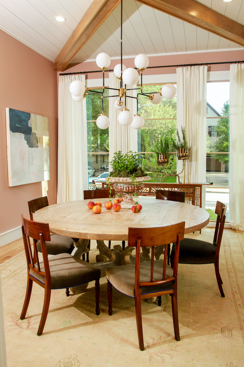 A dining area in a Modern Farmhouse style home, featuring Marvin windows.