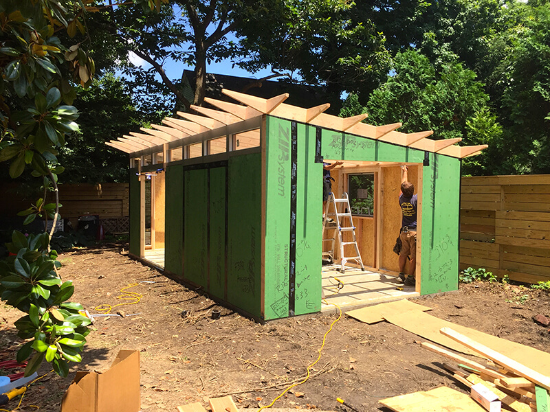 A Studio Shed being built in a backyard.