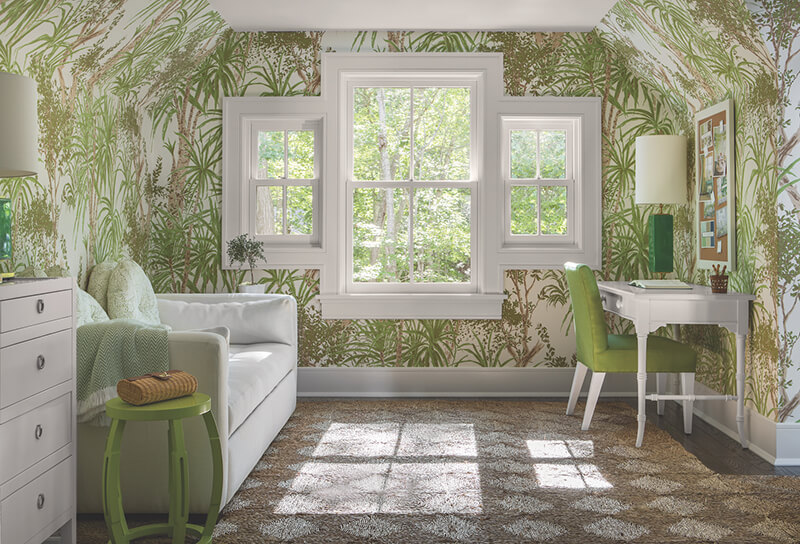 Home office with bold wallpaper and multiple Marvin Windows