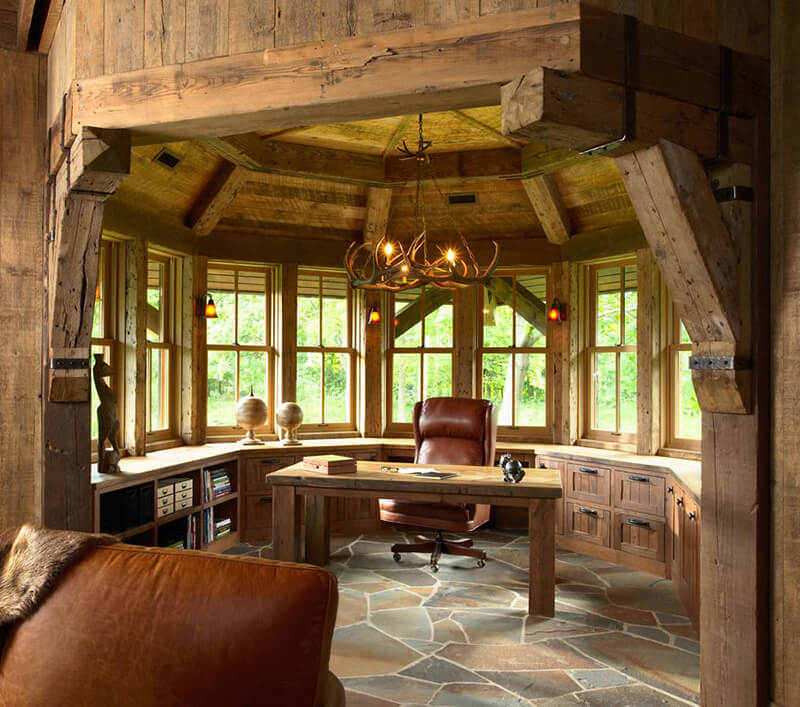 Home office with wood beams and chandelier and multiple Marvin Windows
