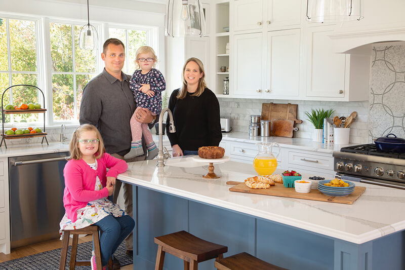Shayla and Scott Adams Family in their kitchen with Marvin Windows