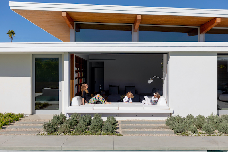 The living platform, or window seat, at the Axiom Desert House featuring Marvin windows and doors.