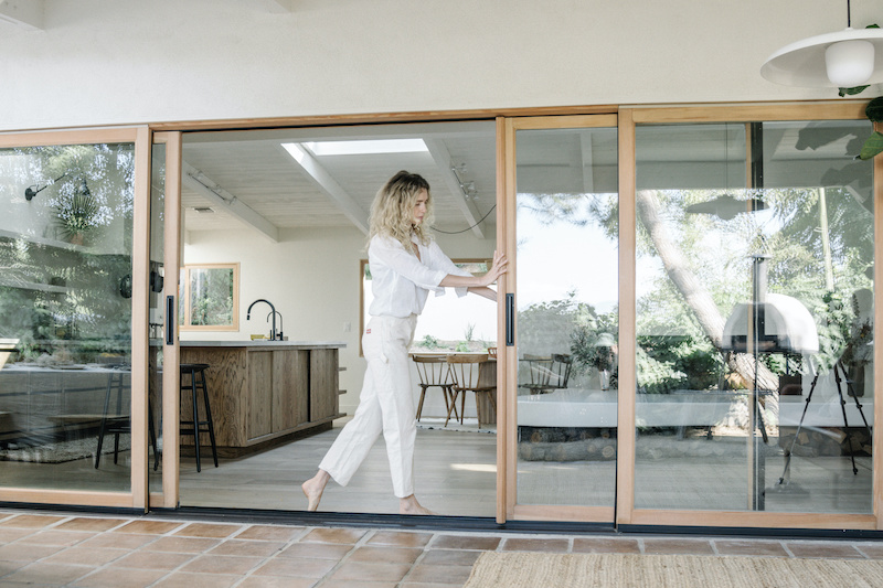 Amber Lestrange opening her Marvin Signature Ultimate Sliding Patio Door.