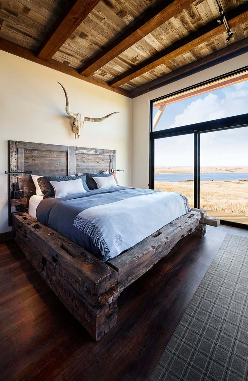 Modern rustic style bedroom with large Marvin Window and Door