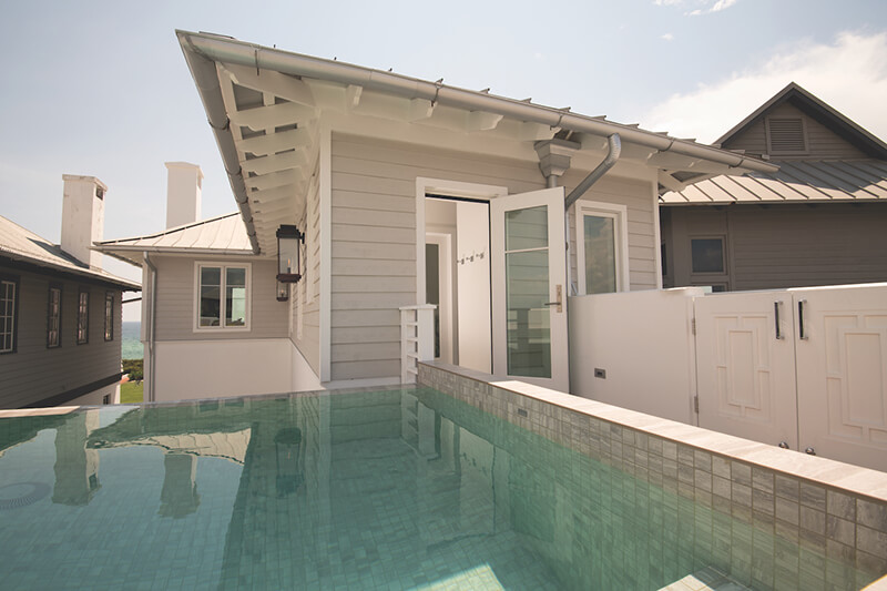 Vern Yip beach home with pool leading up to Marvin Door