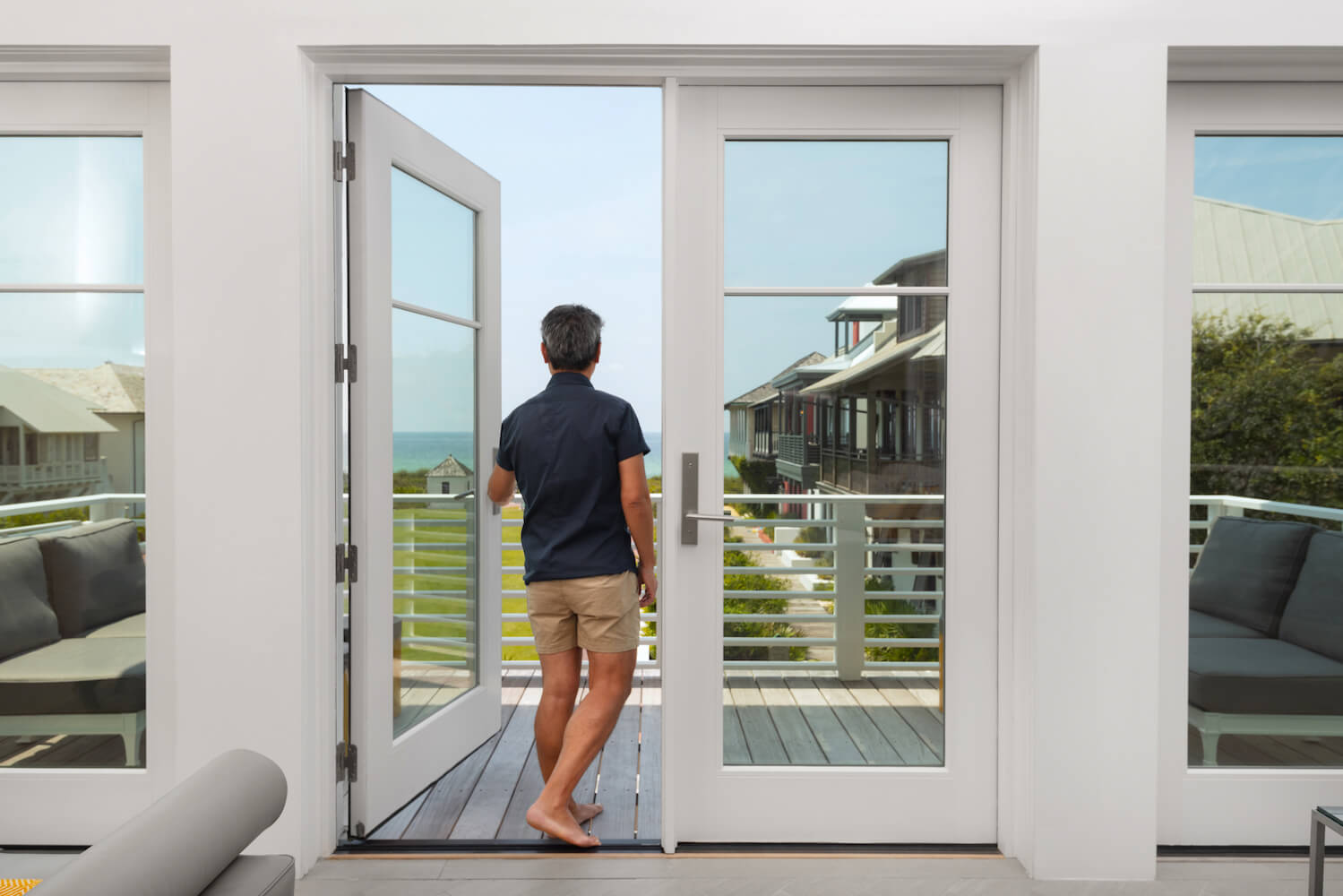 Vern Yip looking out of his beach home Marvin Door