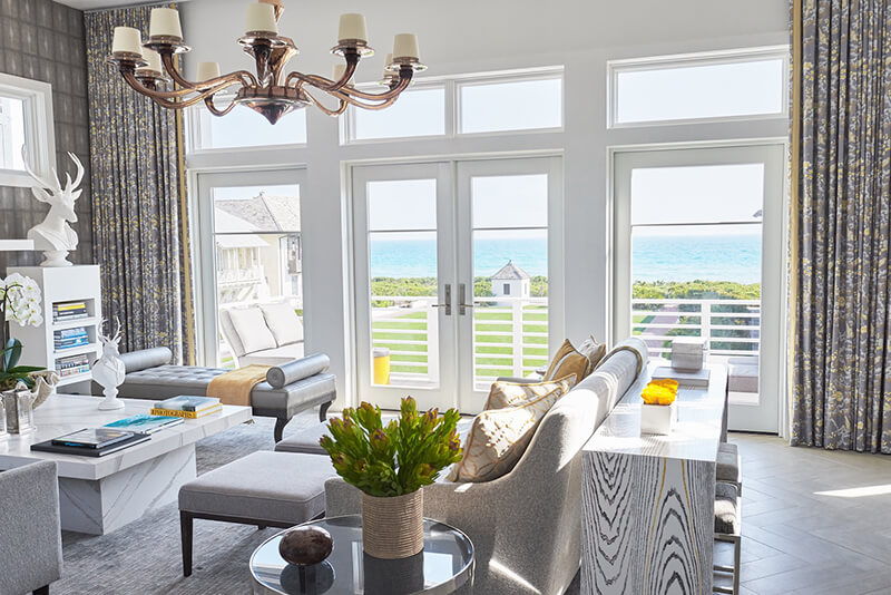 Living room of beach home with multiple Marvin Windows and Doors