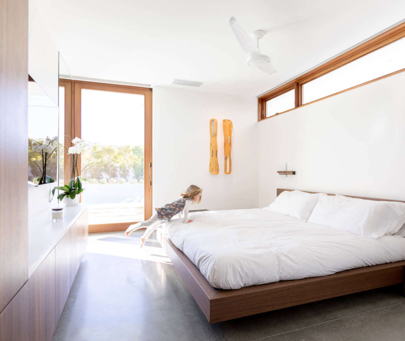 Bedroom with large wood Marvin doors and windows