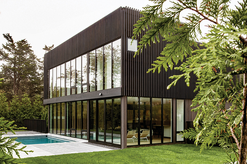 The exterior of a modern home in Sag Harbor, New York, featuring Marvin Modern windows and doors.