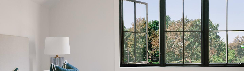 bedroom with open black casement window