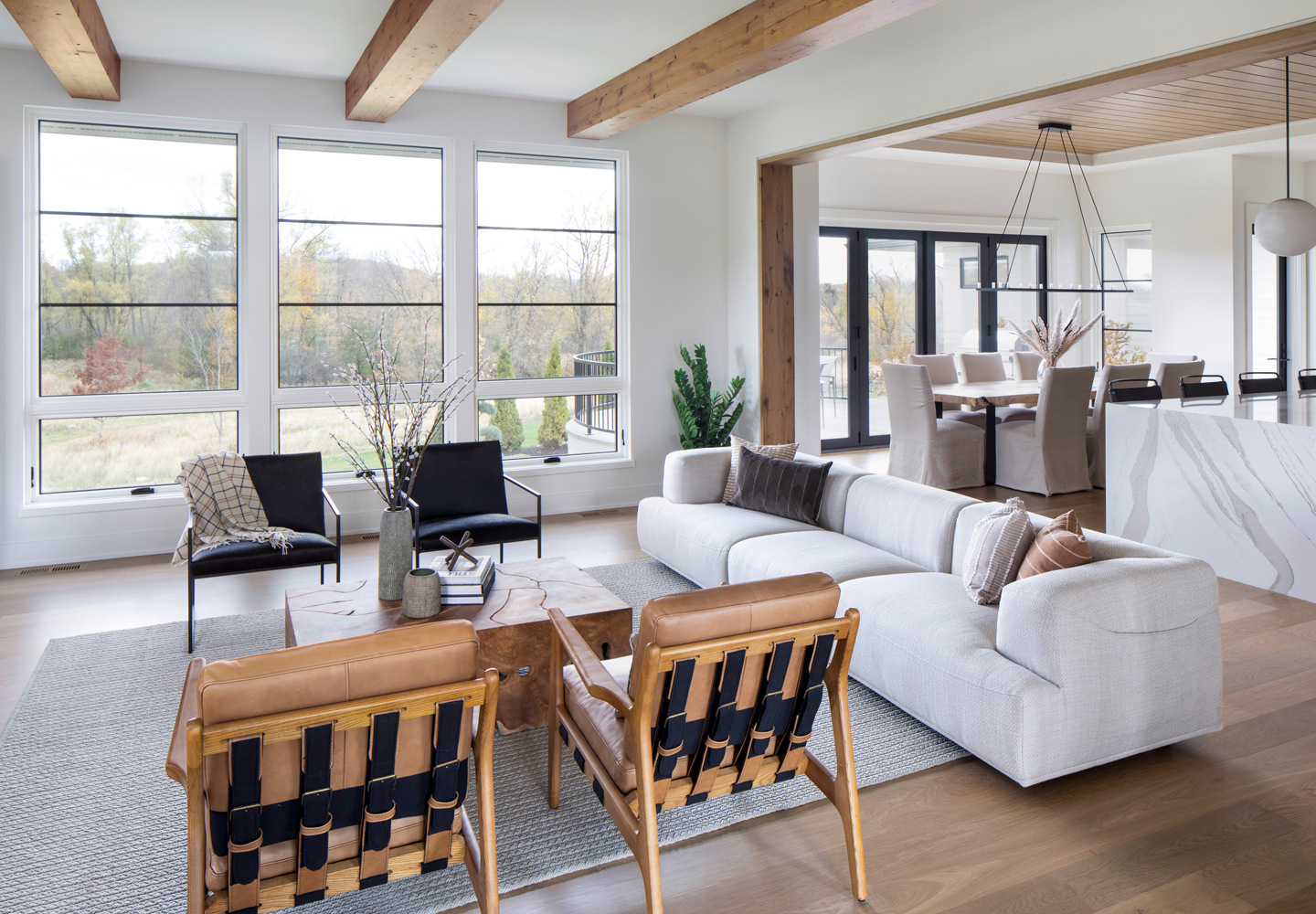 open concept home with awning and casement windows