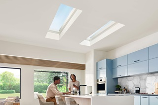 Two people in kitchen with Marvin Awaken Skylights and Marvin Skycove Window Box