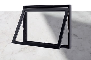 Product shot of Marvin Modern Awning Window with Marble countertop background underneath