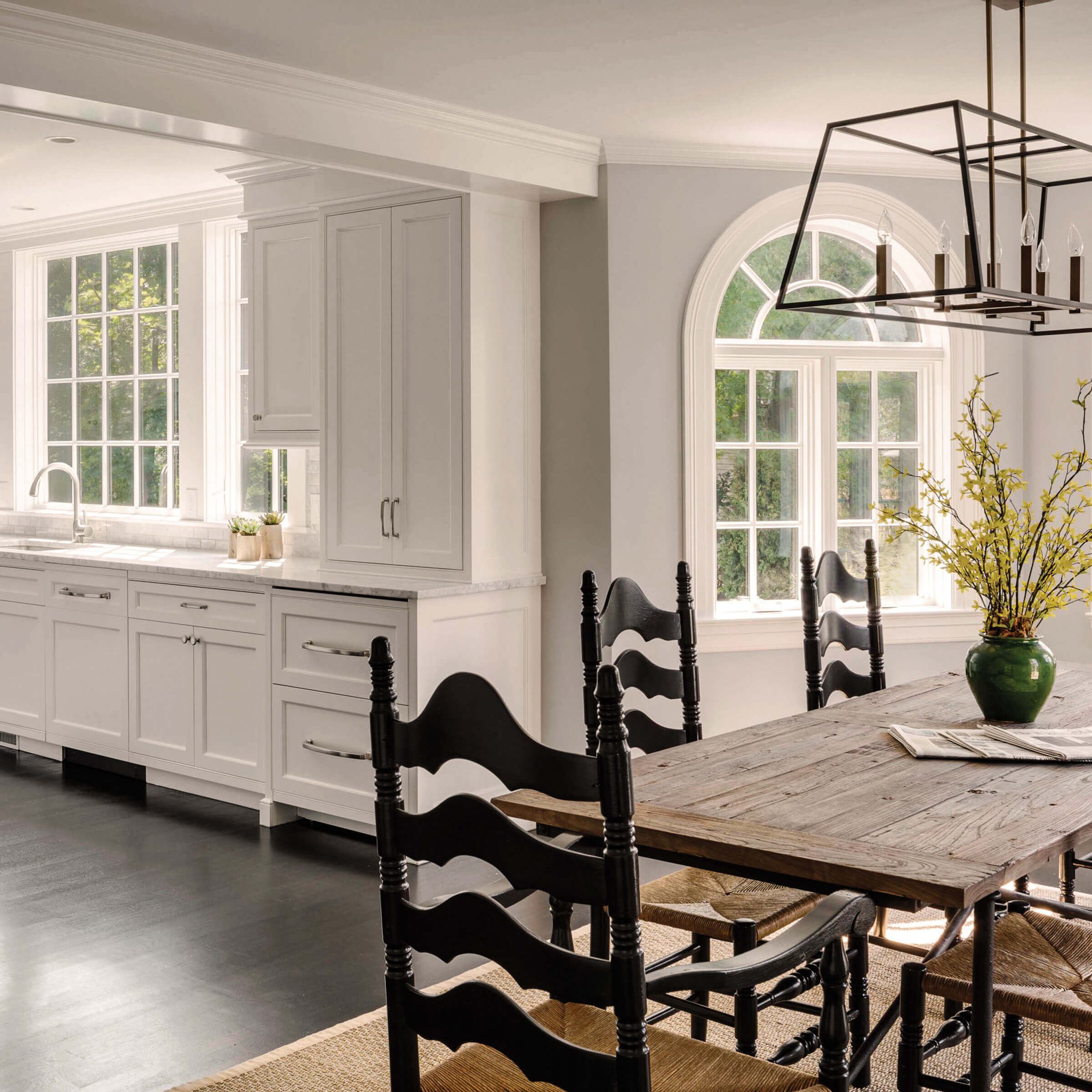 Spacious White Kitchen With Marvin Elevate Round Top Windows