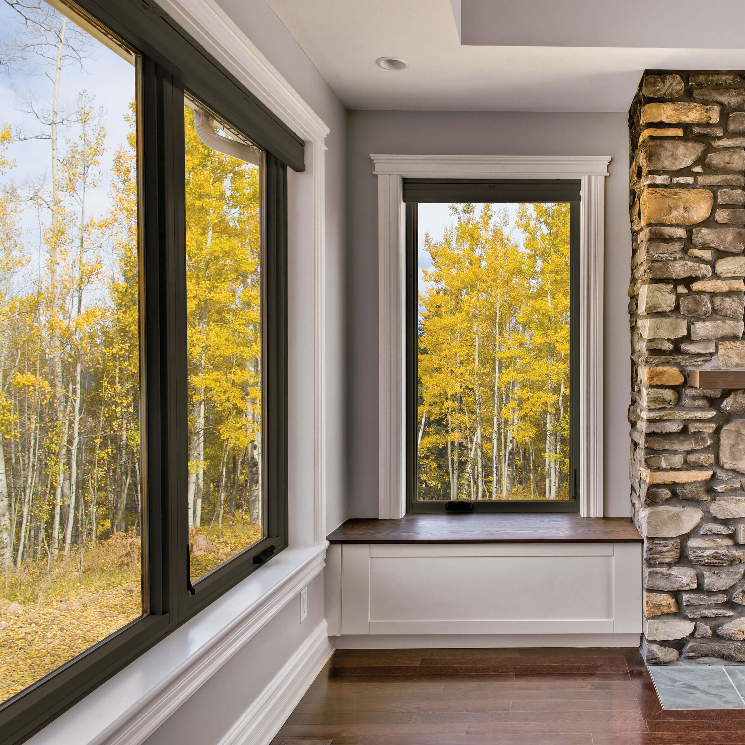 Stone Fireplace In Living Room With Marvin Essential Casement Window