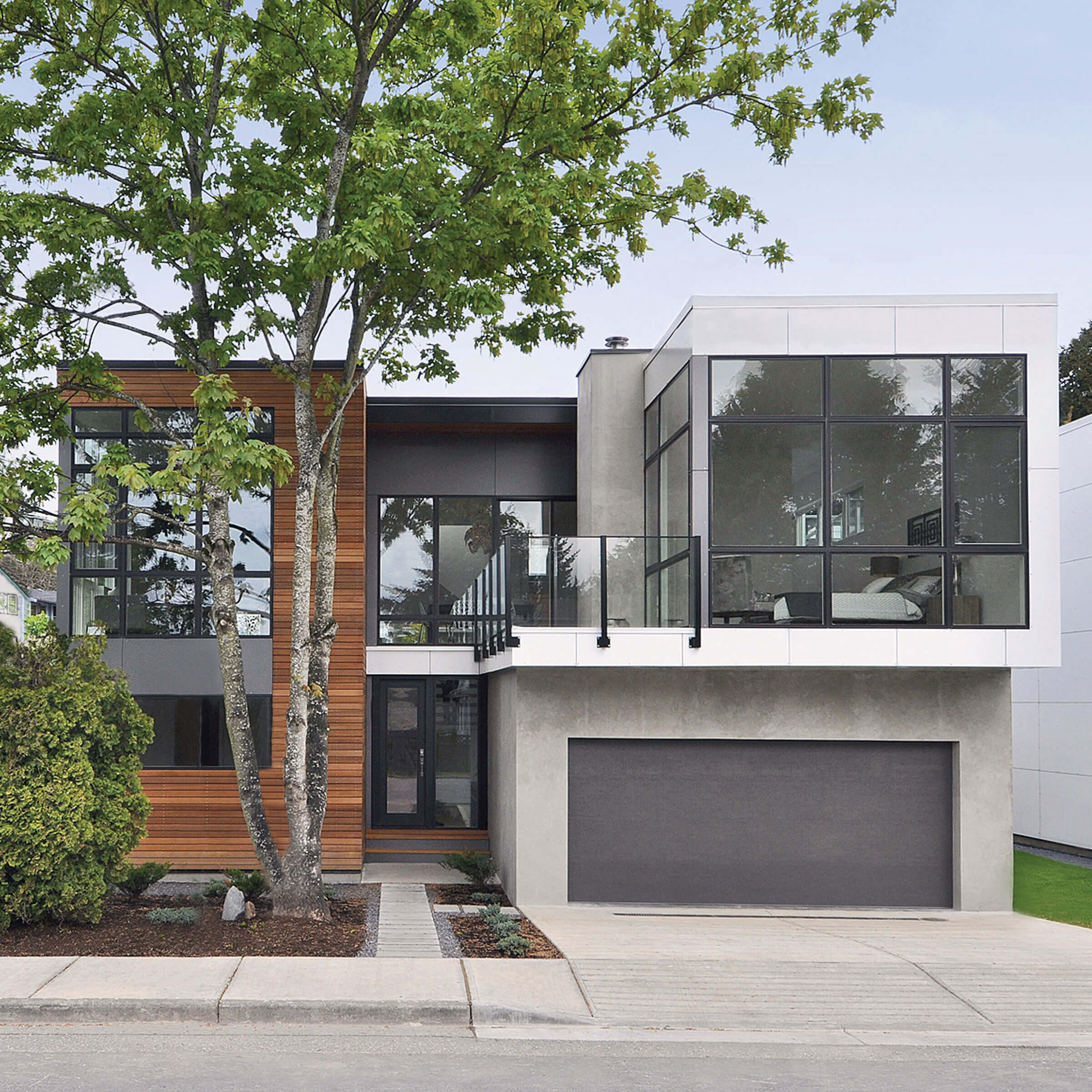 Exterior View Of Contemporary House With Marvin Essential Picture Windows