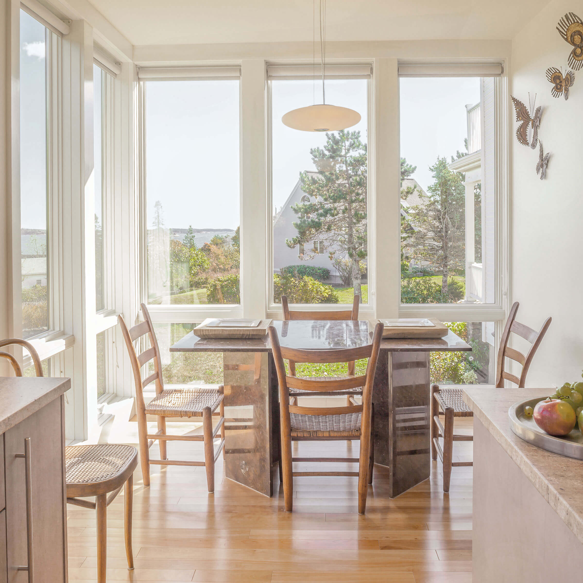 Sunny Dining Area With Elevate Windows