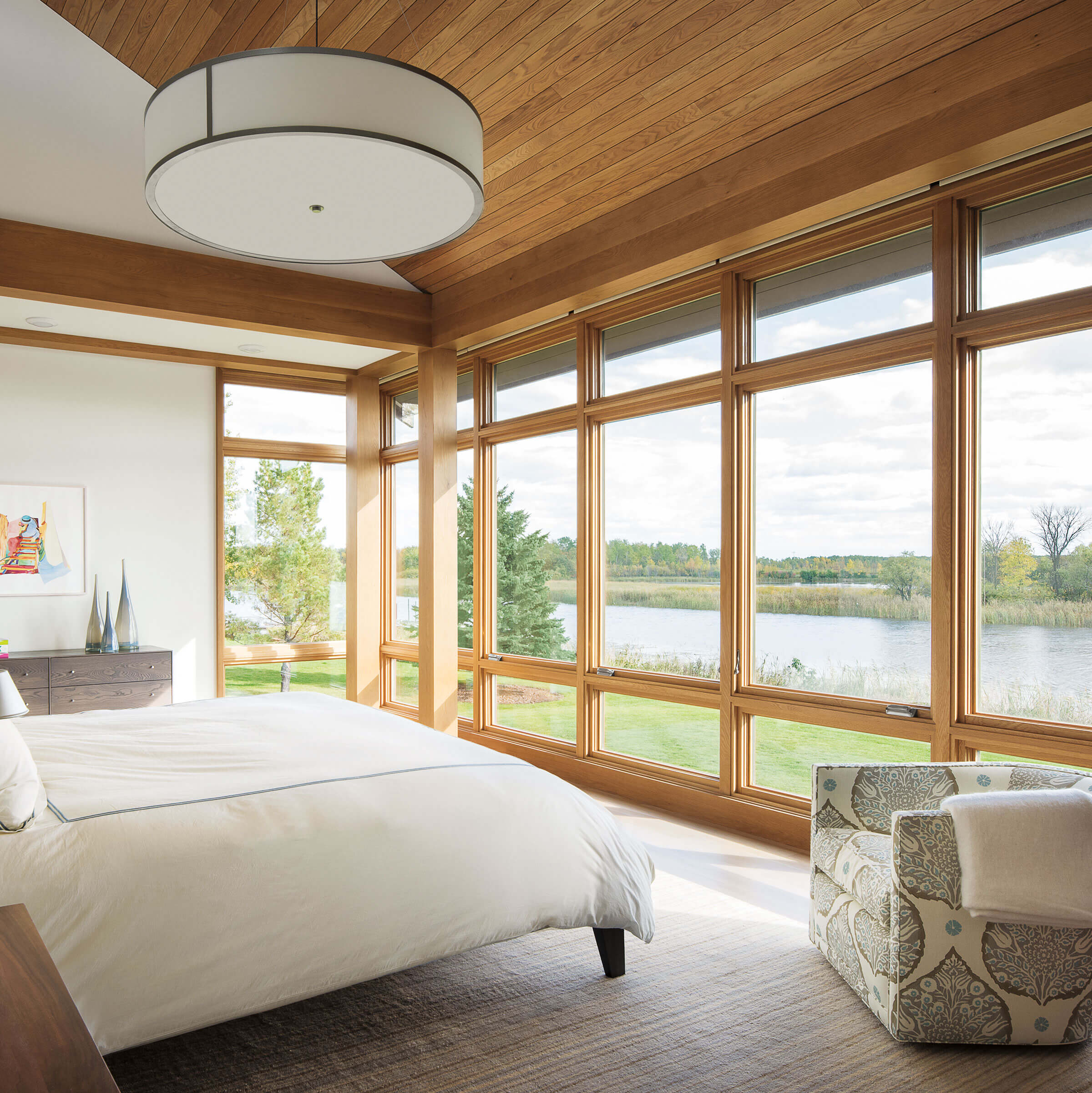 Bedroom With View Of River Through Signature Ultimate Casement Windows