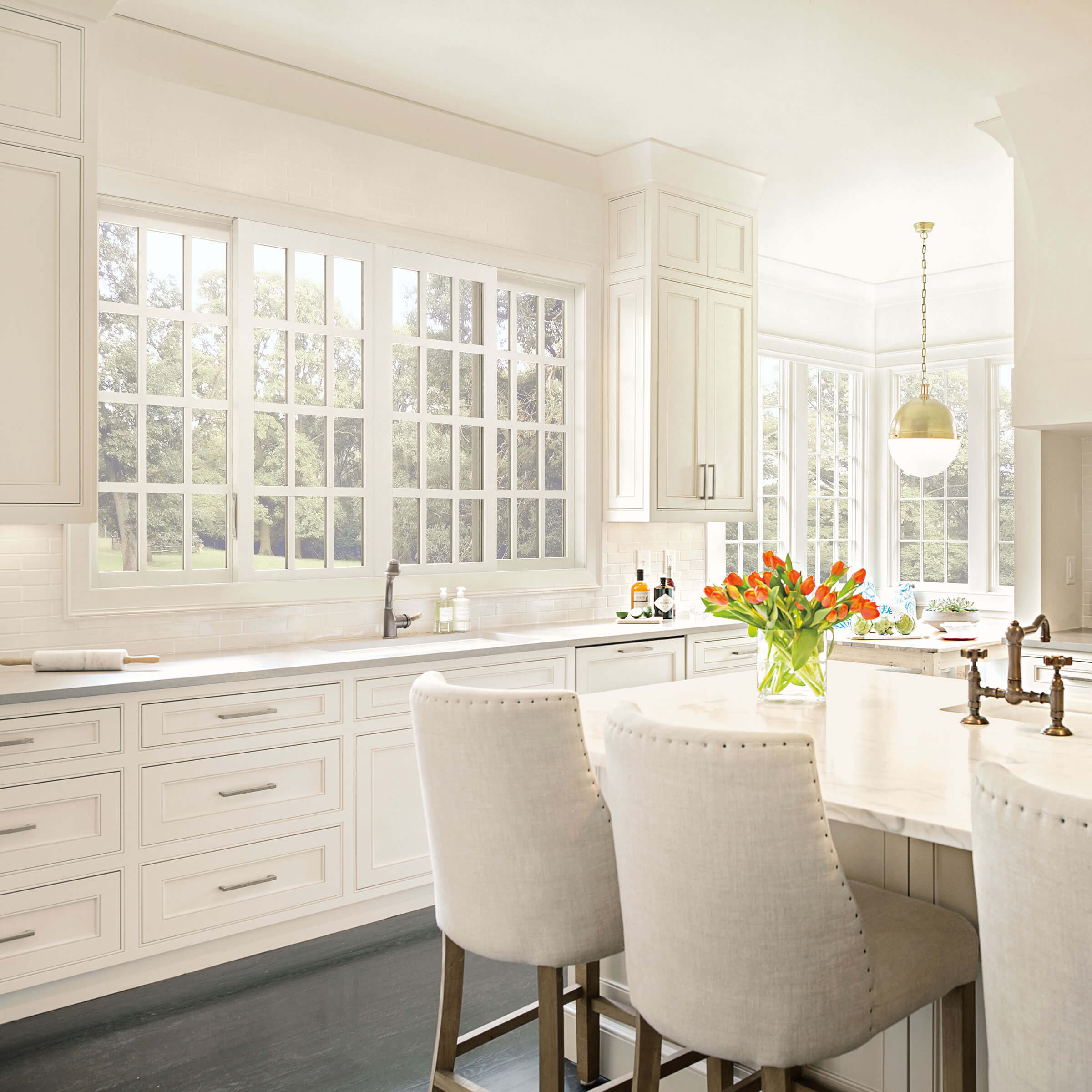 White Kitchen With Signature Ultimate Glider 4 Panel Biparting Windows
